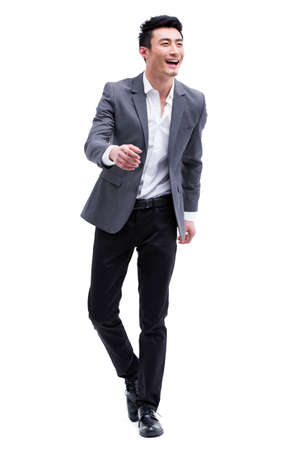 Fashionable businessman on the move LANG_EVOIMAGES