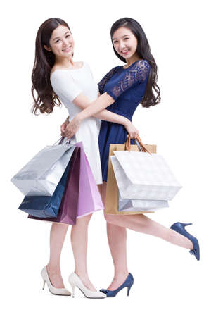 Cheerful female friends shopping