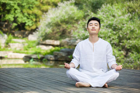 tree position: Young man in meditation