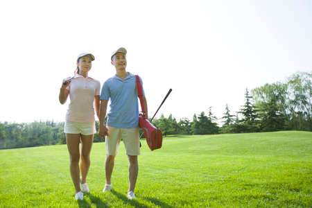 Young couple going to play golf
