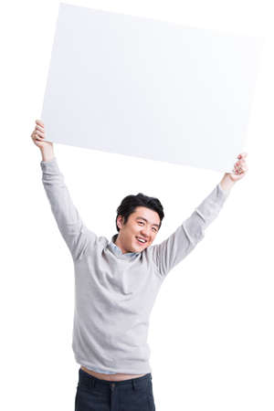 Cheerful young man holding whiteboard LANG_EVOIMAGES