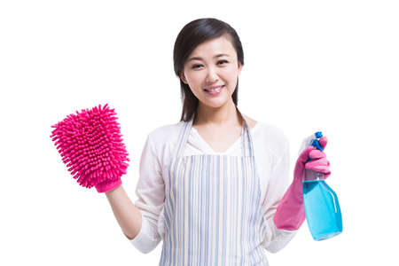Housewife with cleaning product