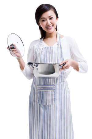 one mature woman only: Happy housewife preparing meal