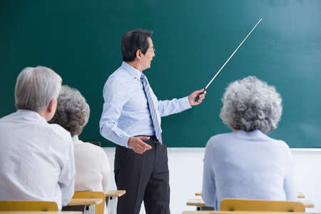 Senior adults having class at school