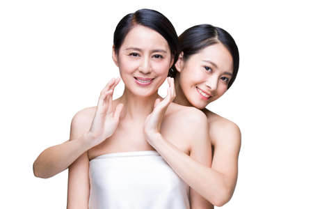 Mother and daughter enjoying beauty treatment