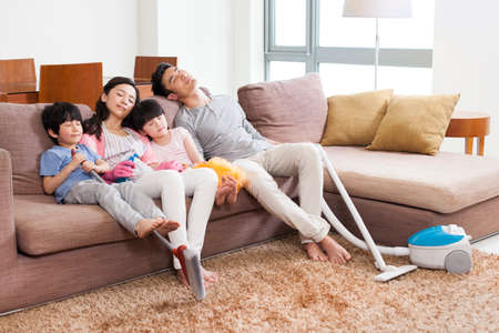 oriental rug: Family resting in sofa after housework
