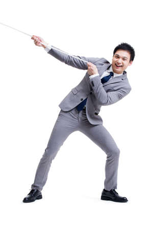 conquering adversity: Excited businessman pulling rope