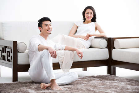 oriental rug: Happy young couple relaxing at home