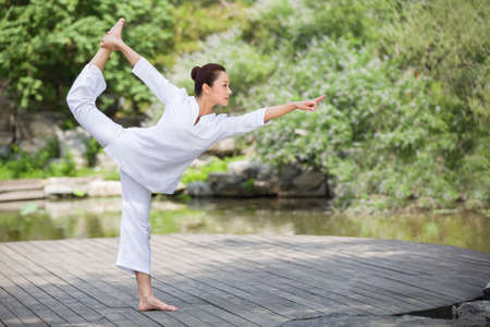 Young woman practicing yoga LANG_EVOIMAGES