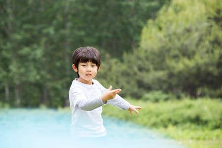 Happy boy playing frisbee