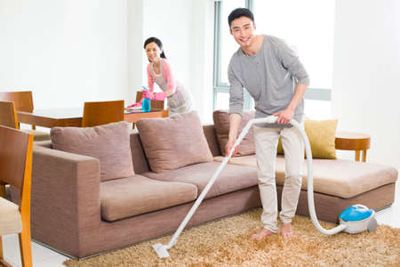 oriental rug: Young couple doing chores at home