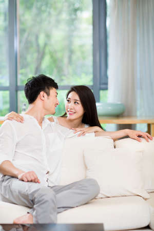 Young couple smiling at each other LANG_EVOIMAGES