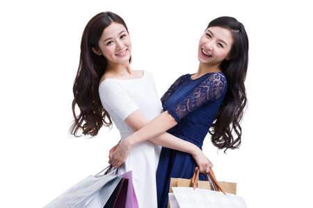 Cheerful female friends shopping