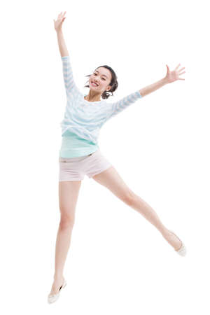 cheer full: Happy young woman jumping LANG_EVOIMAGES
