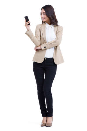 Fashionable businesswoman texting message LANG_EVOIMAGES
