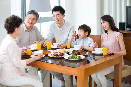 asian foods: Happy family having lunch LANG_EVOIMAGES