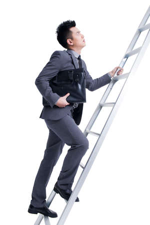 finding out: Businessman climbing ladder LANG_EVOIMAGES