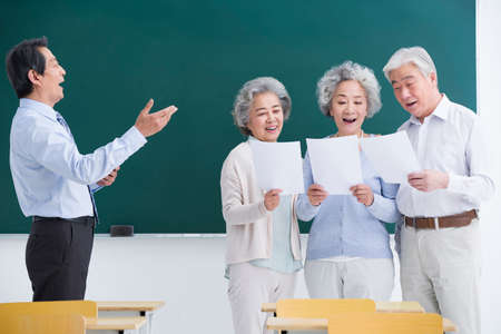 looking for job: Senior adults having music class at school