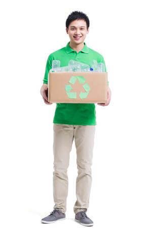 Volunteer recycling plastic bottles