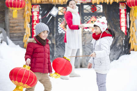 Happy children celebrating Chinese new year LANG_EVOIMAGES