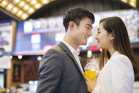 drinks after work: Young couple going to the movies