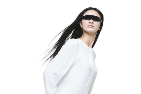 Young woman wearing a pair of smart glasses LANG_EVOIMAGES