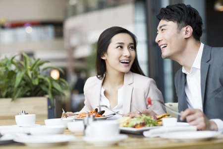 drinks after work: Young couple dining in restaurant LANG_EVOIMAGES