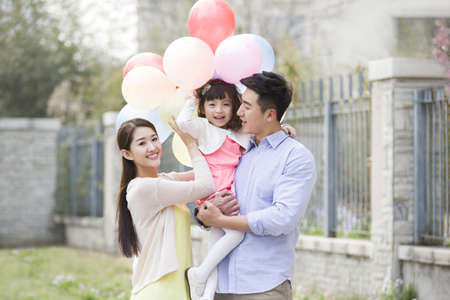 Happy young family with balloons
