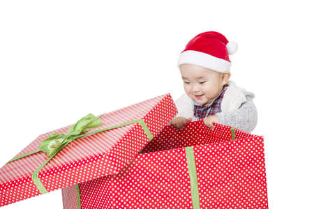 Cute baby unwrapping Christmas gift LANG_EVOIMAGES