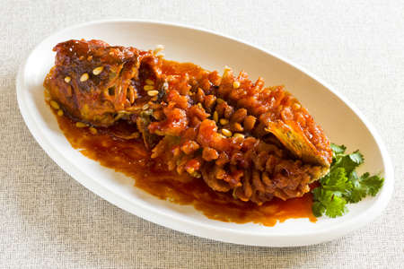 Chinese cuisine fish with pine nuts