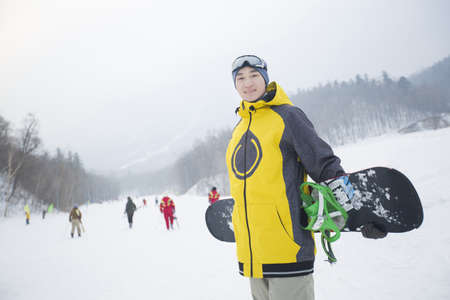 Young man with snowboard on the snow