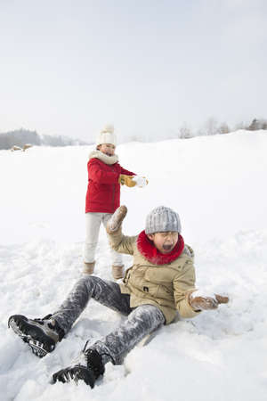 Two children having snowball fight