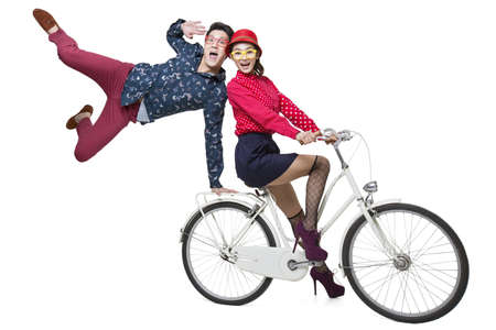 move in: Young couple riding on a bike