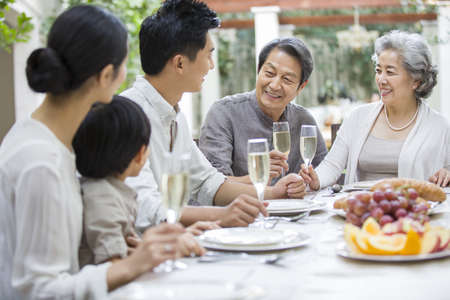 asian foods: Family eating holiday meal together LANG_EVOIMAGES
