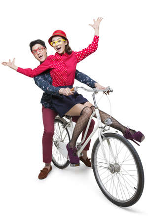Young couple riding on a bike