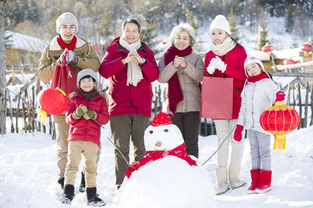 chainlink fence: Happy family celebrating Chinese new year