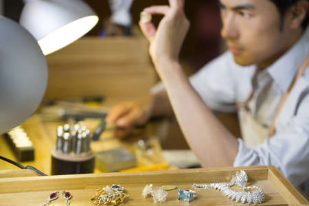 Male jeweler working in studio LANG_EVOIMAGES