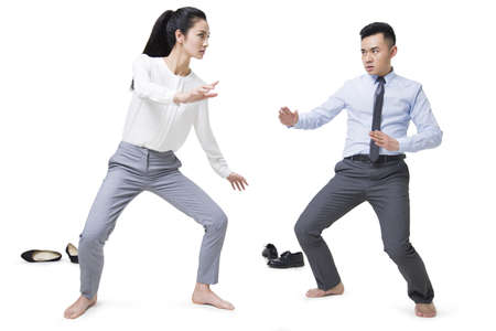 Businessman and businesswoman fighting LANG_EVOIMAGES