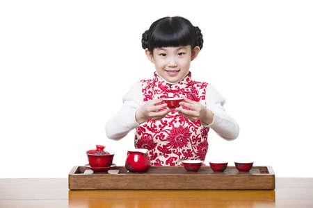 Happy girl performing tea ceremony