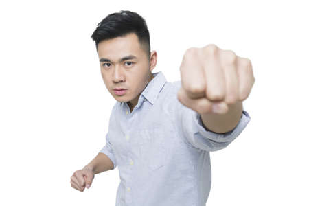 punched out: Young man punching towards the camera