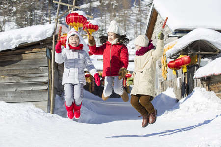 Happy children jumping with candied haws LANG_EVOIMAGES