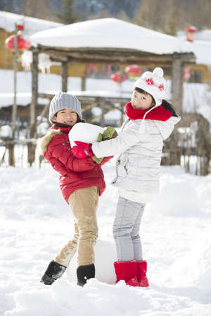 chainlink fence: Happy children playing in the snow