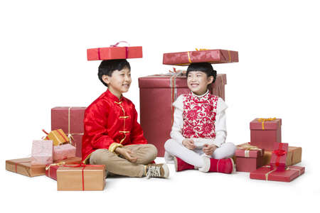 Happy children receiving many Chinese new year gifts