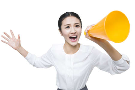 working attire: Young woman shouting into megaphone