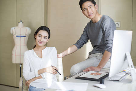 executive apartment: Young couple designing clothing together
