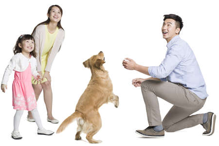 Happy young family with dog