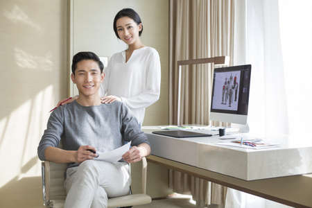 young wife: Young couple designing clothing together