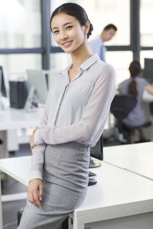 open windows: Portrait of young businesswoman in office
