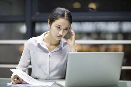 technology: Young businesswoman working in office