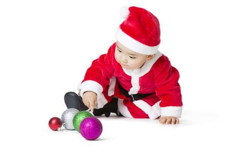 niños vistiendose: Cute bebé en traje de Santa